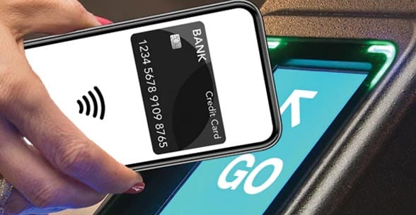 Hand with nfc contactless smartphone over ticket reader