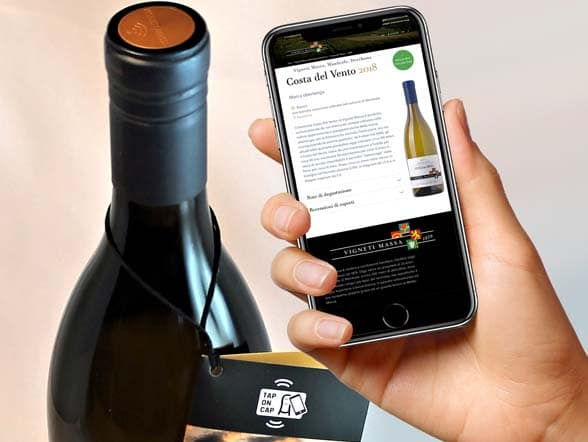 Vigneti massa wine bottle with Guala Nestgate NFC bottle top and NFC phone