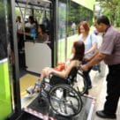 Singapore woman in wheelchair being helped onto LTA bus