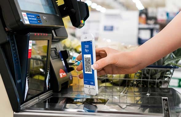 Tesco Pay+ app being used to pay for goods in Tesco Metro