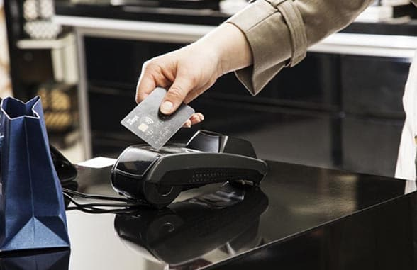 Norway BankAxept contactless payment card being tapped on terminal