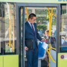 Man using contactless card to board MetLink New Zealand bus