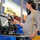 A customer transacts using Walmart Pay