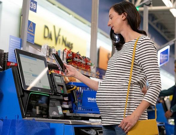 A customer transacts using Walmart Pay