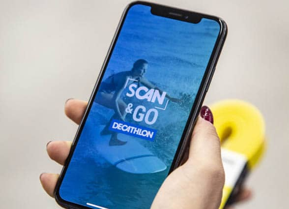 NFC smartphone showing Decathlon Scan & Go mobile self-checkout app