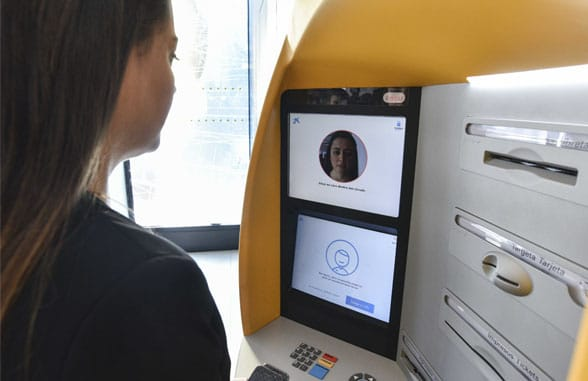 Woman using Caixabank Store biometric atm