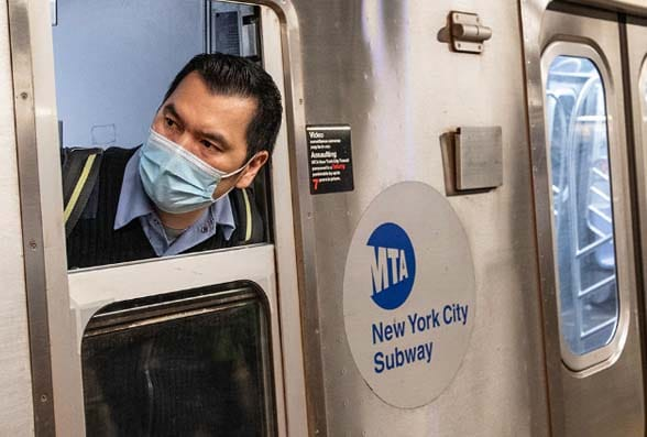 MTA New York man on subway with face mask