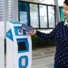 Girl using New Taipei Metro Corporation mobile ticket payments reader