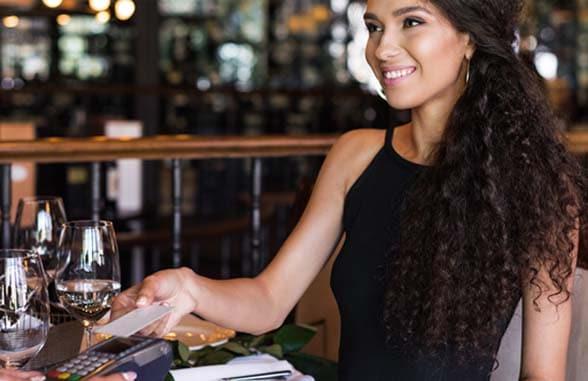 Entrust Datacard survey woman using contactless card