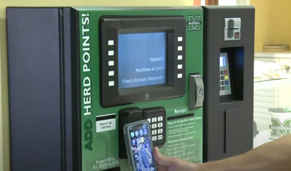 Marshall University student using their NFC mobile ID on campus