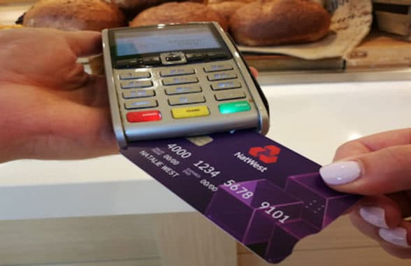 NatWest debit card being put into a card reader