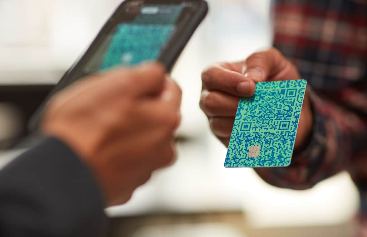 Venmo Credit Card with QR code being tapped on payment terminal