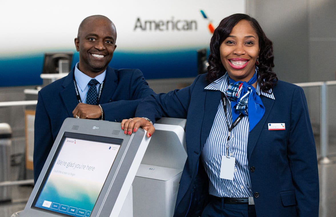 American Airlines check-in desk with check-in staff
