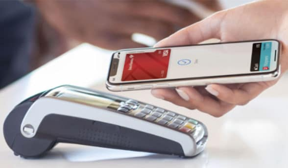 iPhone being used to make Apple Pay contactless NFC payment