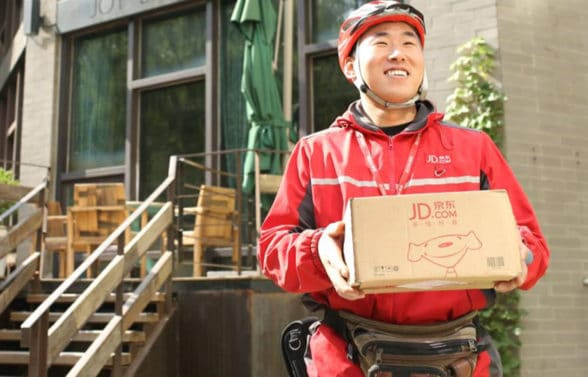 JD.com courier delivering goods bought with digital yuan