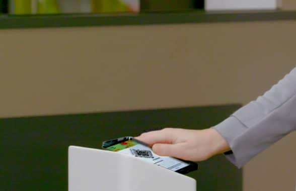 Smartphone tapping Amazon store cashierless reader