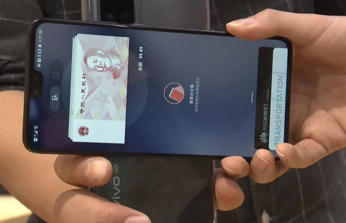 NFC phones being used to pay using digital yuan