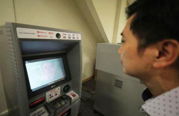 Man using OCBC Bank facial recognition ATM in Singapore