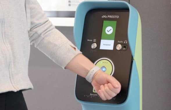 Wearable being used to make a contactless payment on Metrolinx Toronto