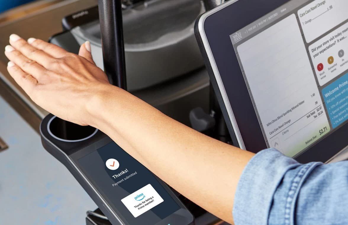 Amazon One pay by palm being used in Whole Foods Market