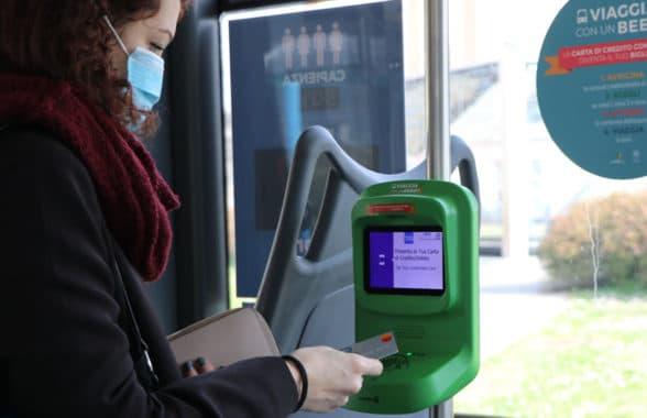 Customer using Brescia Mobilità contactless ticket validator