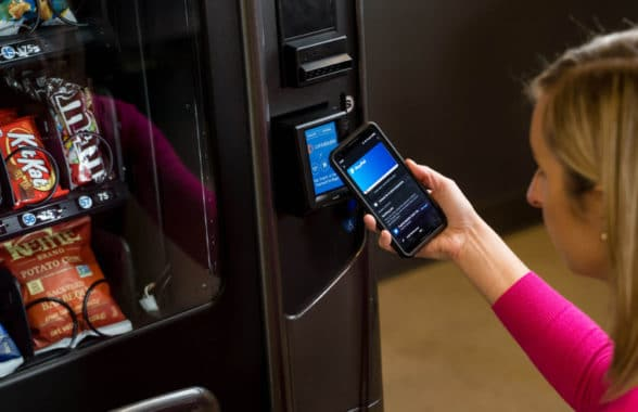 Woman making digital payment at vending machine