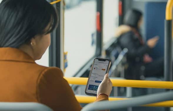 Translink Transit app on woman's phone