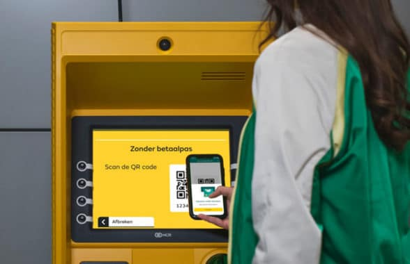 Woman making cardless ATM withdrawal using ABN Amro mobile banking app