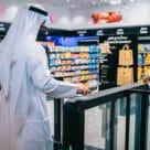 Man enters checkout free Carrefour in Dubai