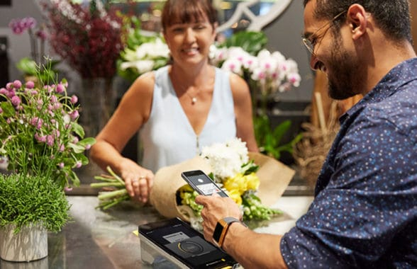contactless payment being made in florist using digital wallet on Apple iPhone