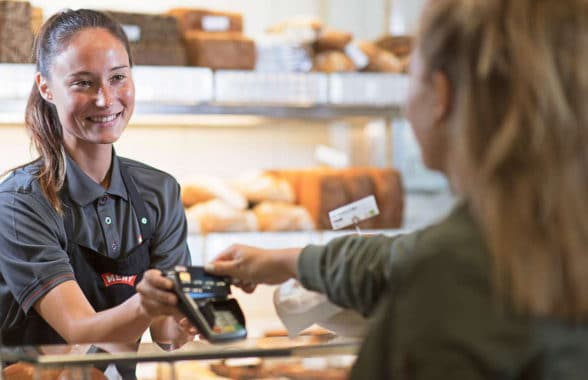 Cashless transaction being made in a bakery in Germany