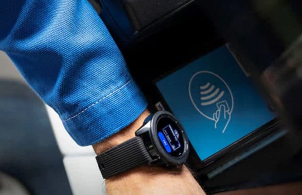 Mobile wallet on a smartwatch being used to make a contactless payment