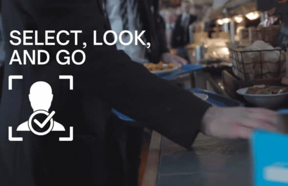 Student hand reaching for meal having paid for meal using contactless face recognition